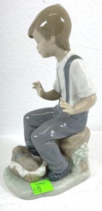 N A O Figurine Boy Sitting With Puppy In Basket