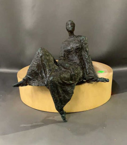 Hot Metal Seated Lady On A Block Of Wood