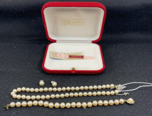 Pearl Necklace, Bracelet And Earrings In A