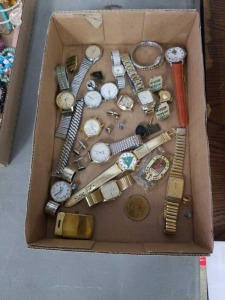 Flat of watches and other items