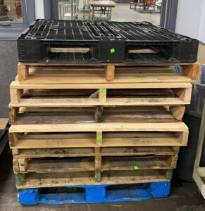 8 Wooden Skids With One Plastic Skid 40x48